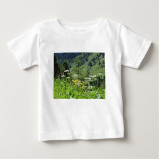 Alpine landscape with wildflowers and firs baby T-Shirt