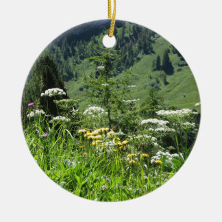 Alpine landscape with wildflowers and firs ceramic ornament