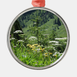 Alpine landscape with wildflowers and firs metal ornament