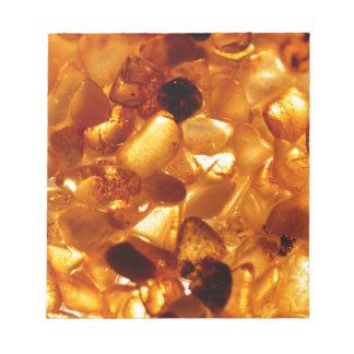 Amber grains with backlight illumination notepad