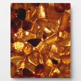 Amber grains with backlight illumination plaque