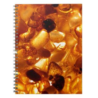 Amber grains with backlight illumination spiral notebook