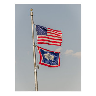 American and Wyoming flags blowing in the wind Postcard
