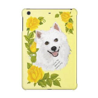 American Eskimo Dog and Yellow Roses