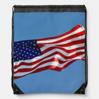 American Flag in the Wind Drawstring Bag