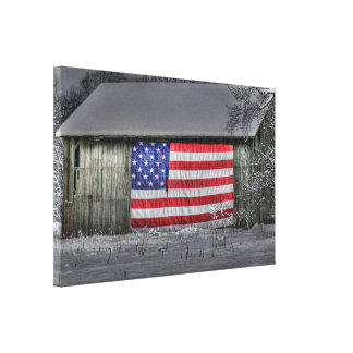 American flag on old barn canvas print
