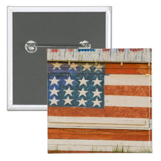 American flag painted onto fireworks stand near 15 cm square badge