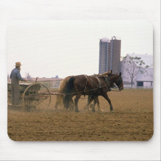 Amish farmer using a horse drawn seed planter mouse pad