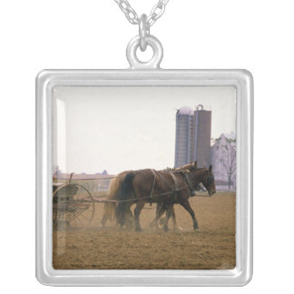 Amish farmer using a horse drawn seed planter square pendant necklace