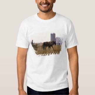 Amish farmer using a horse drawn seed planter tee shirts