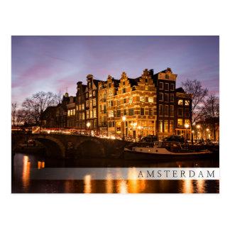 Amsterdam canal houses at dusk bar postcard