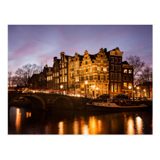 Amsterdam canal houses at dusk postcard
