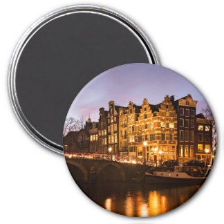 Amsterdam canal houses at dusk round magnet
