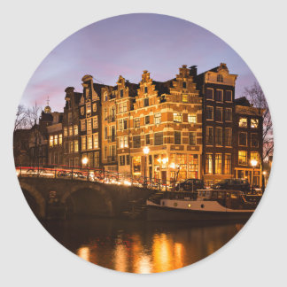 Amsterdam canal houses at dusk round sticker