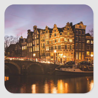 Amsterdam canal houses at dusk sticker