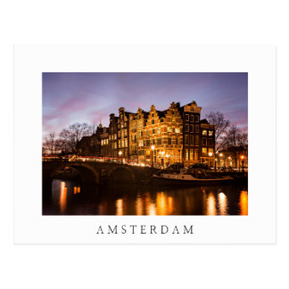 Amsterdam canal houses at dusk white postcard