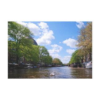 Amsterdam. Canal. Swan. Canvas Print