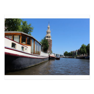 Amsterdam canal view - Boats and spire Postcard