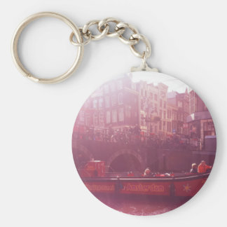 amsterdam canal view with cruise boat key ring