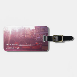 amsterdam canal view with cruise boat luggage tag