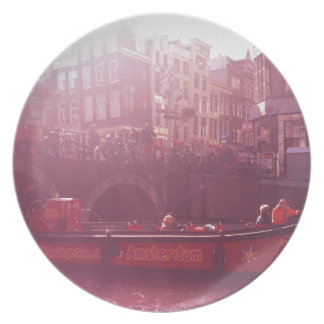 amsterdam canal view with cruise boat plate