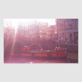 amsterdam canal view with cruise boat rectangular sticker
