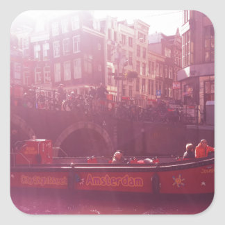 amsterdam canal view with cruise boat square sticker