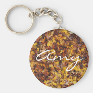 Amy keychain with leaf litter background