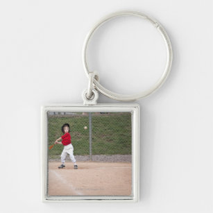 ce8651360 An action shot of a 5 year old baseball player key ring