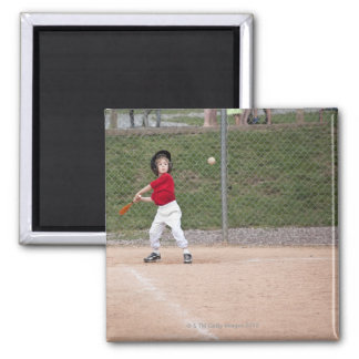 An action shot of a 5 year old baseball player square magnet