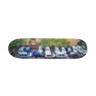 An aerial view of parked cars and bikes skate boards