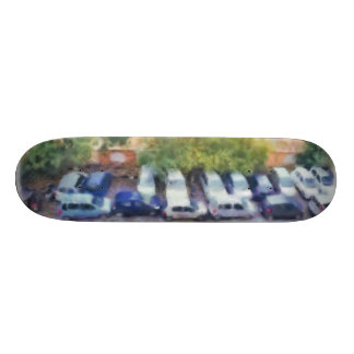 An aerial view of parked cars and bikes skateboard deck