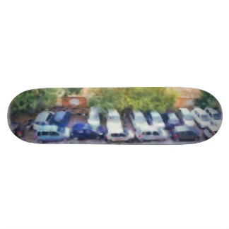 An aerial view of parked cars and bikes 19.7 cm skateboard deck
