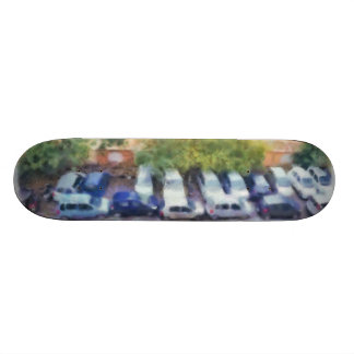 An aerial view of parked cars and bikes skate board