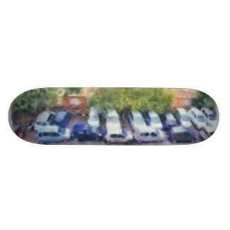 An aerial view of parked cars and bikes custom skate board