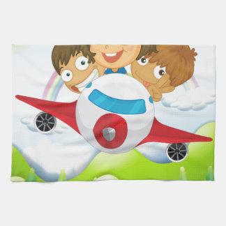 An airplane with three playful kids hand towel
