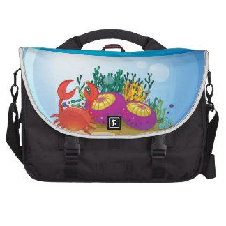 An aquarium with sea creatures bag for laptop