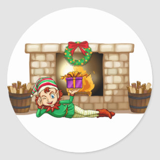 An elf in front of the fireplace round sticker