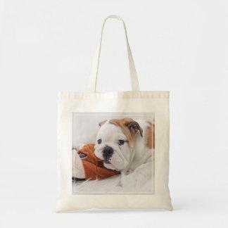 An English Bulldog Puppy Playing With A Bulldog Budget Tote Bag