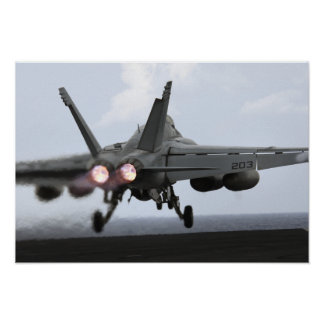 An F/A-18E Super Hornet launches Poster
