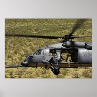An HH-60 Pave Hawk flies over the desert Poster