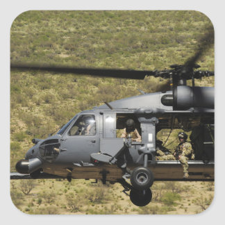 An HH-60 Pave Hawk flies over the desert Square Sticker