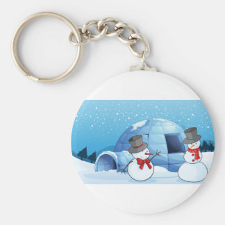 an igloo and snowmen key ring