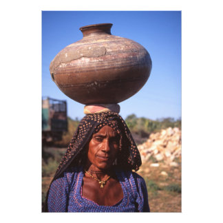 An Indian woman carrying water container Photo Print