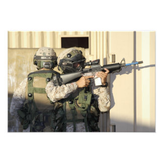An infantry scout aims his weapon photo