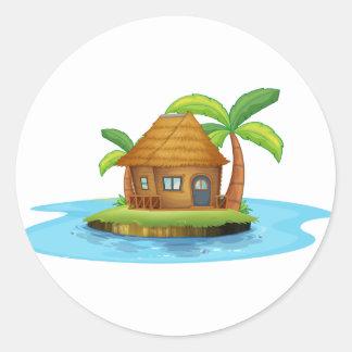 An island with a small nipa hut classic round sticker