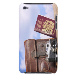 An old leather suitcase, retro camera and iPod touch case