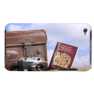 An old leather suitcase, retro camera and iPod touch covers