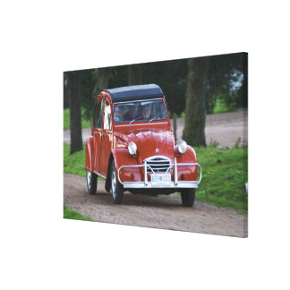 An old red Citroen 2CV car with a smiling woman Gallery Wrapped Canvas