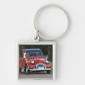 An old red Citroen 2CV car with a smiling woman Key Ring